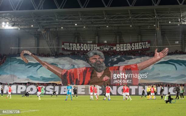 Hapoel BeerSheva supporters raise a large motif at the end of the first leg of their UEFA Europa League football match between Hapoel BeerSheva and...