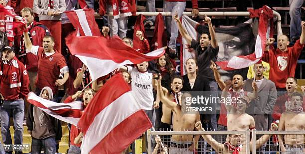 Hapoel TelAviv fans celebrate their teams 10 victory in the UEFA Cup 1st round 2nd leg football match between AIK and Hapoel TelAviv at the Rasunda...