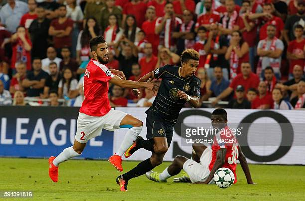 Hapoel's Ben Bitton tries to tackle Celtic's Scott Sinclair during the UEFA Champions League group stages playoff football match between Celtic and...