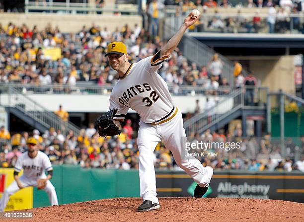 A Happ of the Pittsburgh Pirates pitches in the third inning during the game against the Cincinnati Reds at PNC Park on October 4 2015 in Pittsburgh...