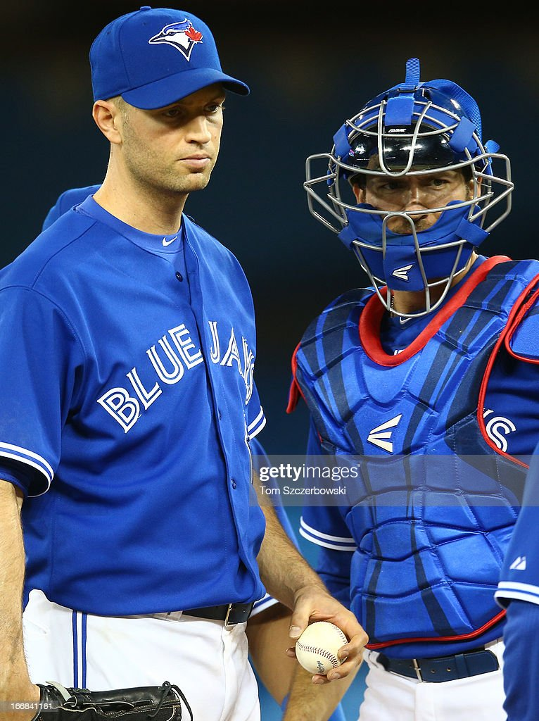 <a gi-track='captionPersonalityLinkClicked' href=/galleries/search?phrase=J.A.+Happ&family=editorial&specificpeople=4175351 ng-click='$event.stopPropagation()'>J.A. Happ</a> #48 of the Toronto Blue Jays and <a gi-track='captionPersonalityLinkClicked' href=/galleries/search?phrase=J.P.+Arencibia&family=editorial&specificpeople=4959430 ng-click='$event.stopPropagation()'>J.P. Arencibia</a> #9 look on as Happ is relieved in the sixth inning during MLB game action against the Chicago White Sox on April 17, 2013 at Rogers Centre in Toronto, Ontario, Canada.