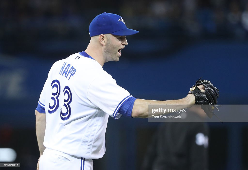 <a gi-track='captionPersonalityLinkClicked' href=/galleries/search?phrase=J.A.+Happ&family=editorial&specificpeople=4175351 ng-click='$event.stopPropagation()'>J.A. Happ</a> #33 of the Toronto Blue Jays celebrates after getting a double play to end the third inning during MLB game action against the Texas Rangers on May 5, 2016 at Rogers Centre in Toronto, Ontario, Canada.