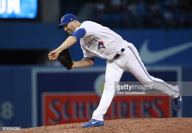 A Happ of the Toronto Blue Jays delivers a pitch in the fifth inning during MLB game action against the Los Angeles Angels of Anaheim at Rogers...
