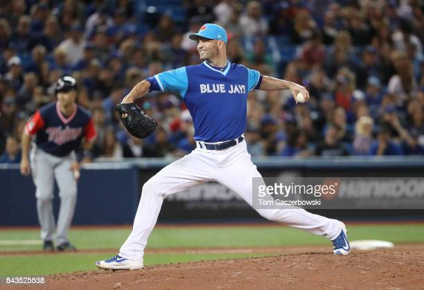A Happ of the Toronto Blue Jays delivers a pitch in the fifth inning during MLB game action against the Minnesota Twins at Rogers Centre on August 25...