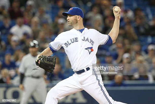 A Happ of the Toronto Blue Jays delivers a pitch in the first inning during MLB game action against the New York Yankees on April 13 2016 at Rogers...