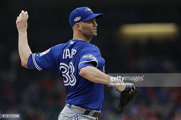 A Happ of the Toronto Blue Jays delivers a pitch in the first inning against the Texas Rangers in game two of the American League Divison Series at...