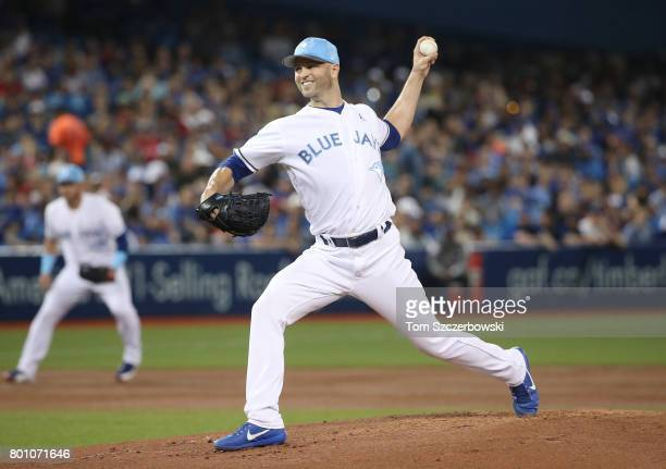 A Happ of the Toronto Blue Jays delivers a pitch in the first inning during MLB game action against the Chicago White Sox at Rogers Centre on June 18...
