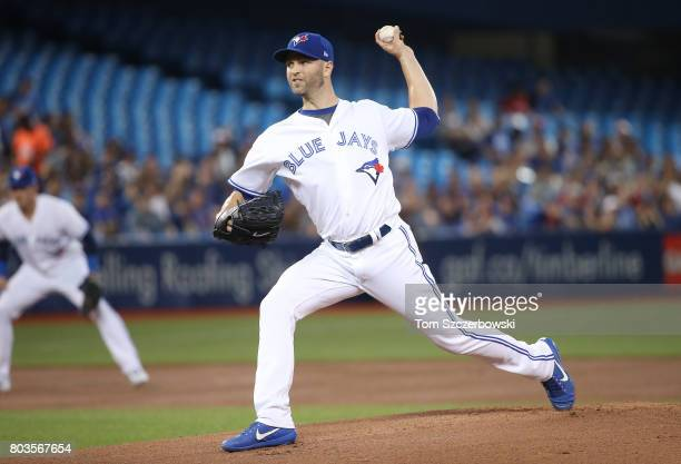 A Happ of the Toronto Blue Jays delivers a pitch in the first inning during MLB game action against the Baltimore Orioles at Rogers Centre on June 29...