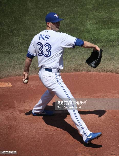A Happ of the Toronto Blue Jays delivers a pitch in the first inning during MLB game action against the Pittsburgh Pirates at Rogers Centre on August...