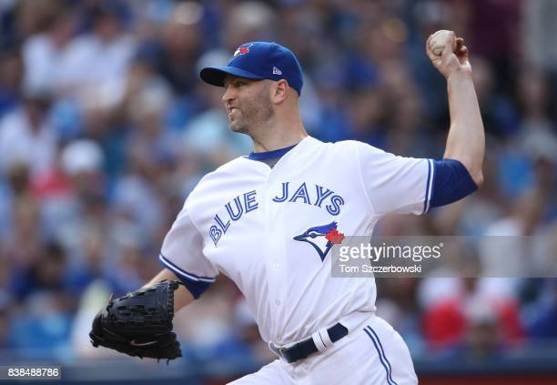 A Happ of the Toronto Blue Jays delivers a pitch in the first inning during MLB game action against the New York Yankees at Rogers Centre on August 8...