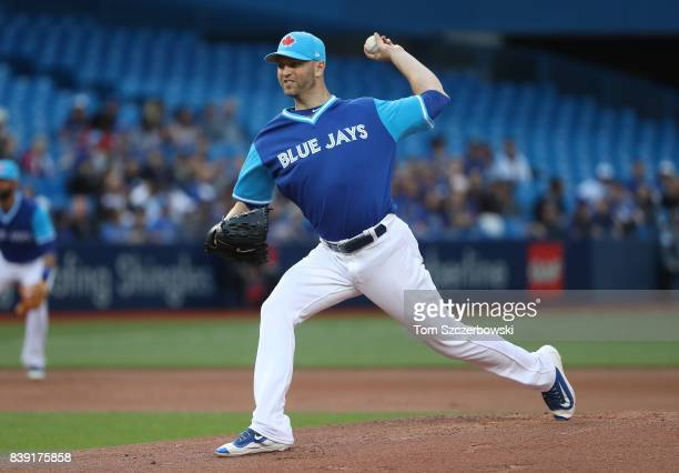 A Happ of the Toronto Blue Jays delivers a pitch in the first inning during MLB game action against the Minnesota Twins at Rogers Centre on August 25...