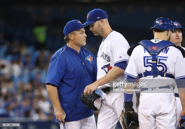 A Happ of the Toronto Blue Jays exits the game as he is relieved by manager John Gibbons in the seventh inning during MLB game action against the...