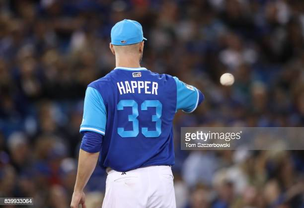 A Happ of the Toronto Blue Jays gets the ball back during MLB game action against the Minnesota Twins at Rogers Centre on August 25 2017 in Toronto...