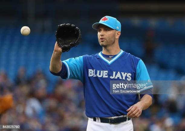 A Happ of the Toronto Blue Jays gets the baseball back during MLB game action against the Minnesota Twins at Rogers Centre on August 25 2017 in...
