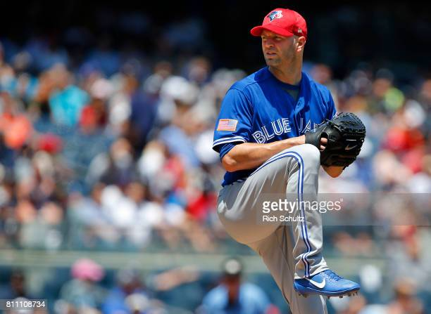 A Happ of the Toronto Blue Jays in action against the New York Yankees during a game at Yankee Stadium on July 4 2017 in the Bronx borough of New...