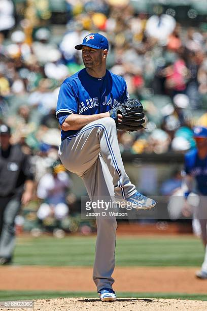 A Happ of the Toronto Blue Jays pitches against the Oakland Athletics during the first inning at the Oakland Coliseum on July 17 2016 in Oakland...