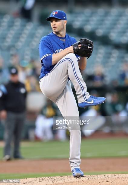 A Happ of the Toronto Blue Jays pitches against the Oakland Athletics in the first inning at Oakland Alameda Coliseum on June 5 2017 in Oakland...