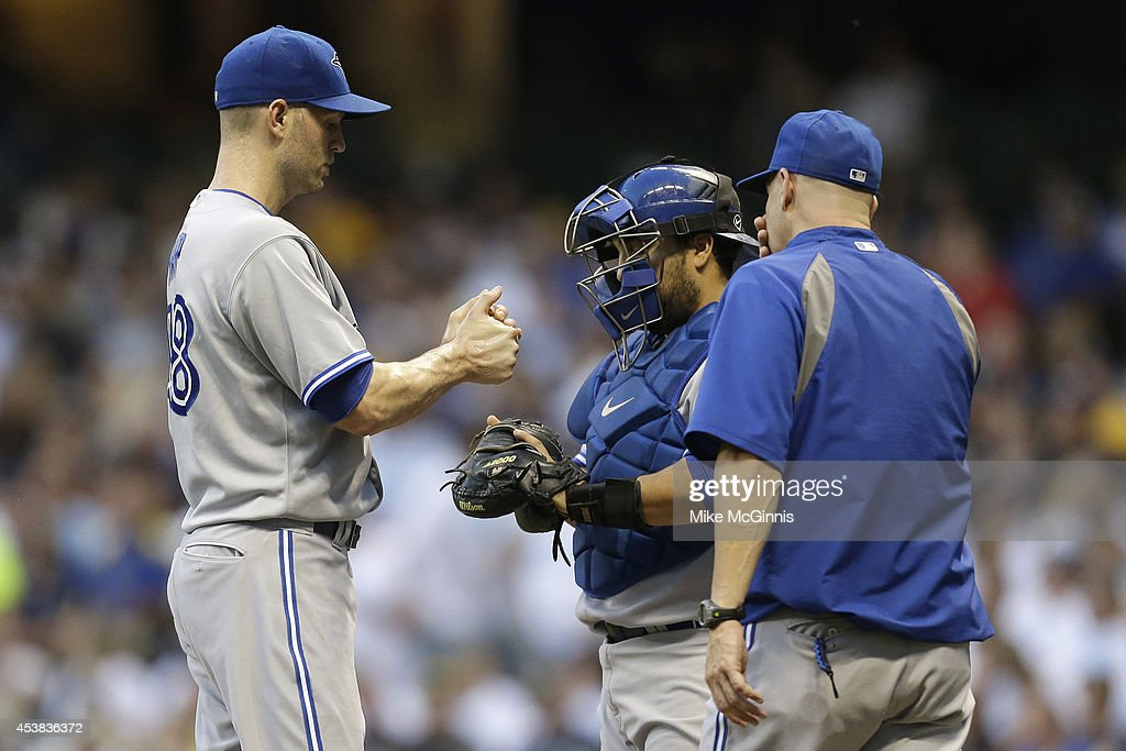 J.A. Happ #48 of the Toronto Blue Jays pitches during the first inning against the Milwaukee Brewers during the Interleague game at Miller Park on August 19, 2014 in Milwaukee, Wisconsin.