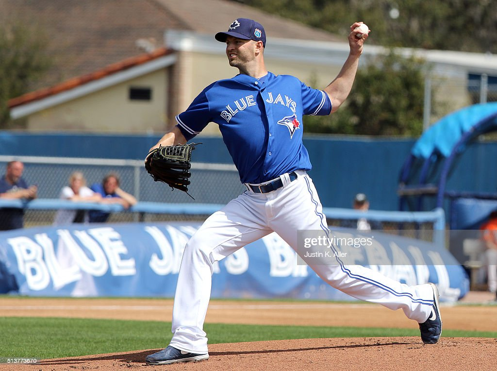 J.A. Happ #33 of the Toronto Blue Jays pitches during the game against the Baltimore Orioles at Florida Auto Exchange Stadium on March 4, 2016 in Dunedin, Florida.