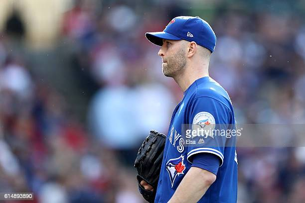 A Happ of the Toronto Blue Jays reacts in the first inning against the Cleveland Indians during game two of the American League Championship Series...