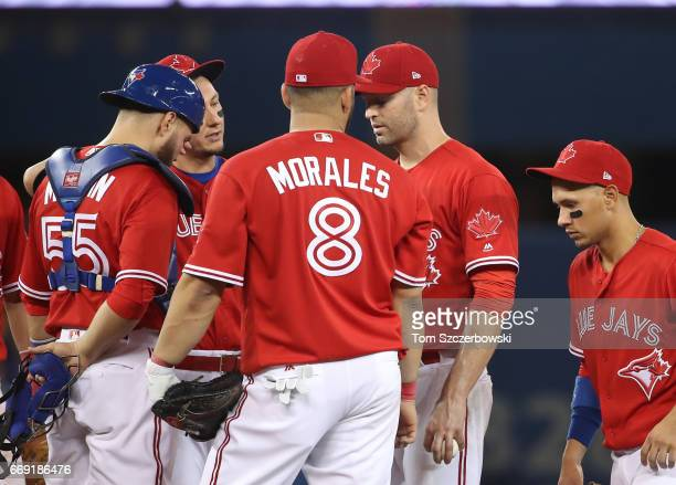 A Happ of the Toronto Blue Jays reacts moments before being forced to exit the game due to an arm injury in the fifth inning during MLB game action...
