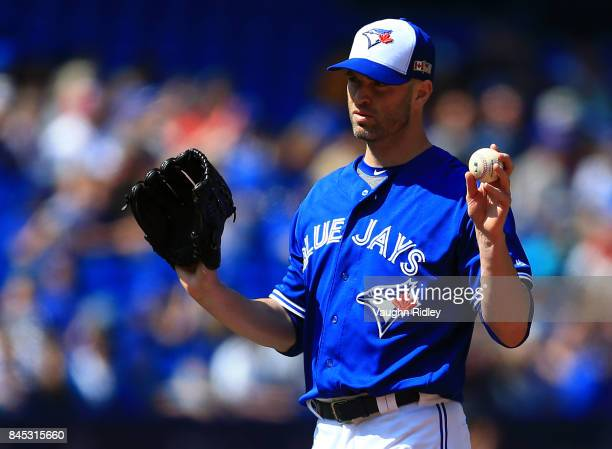 A Happ of the Toronto Blue Jays signals for a new ball in the first inning during MLB game action against the Detroit Tigers at Rogers Centre on...