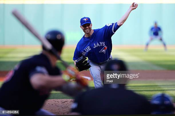 A Happ of the Toronto Blue Jays throws out a first pitch in the first inning against the Cleveland Indians during game two of the American League...