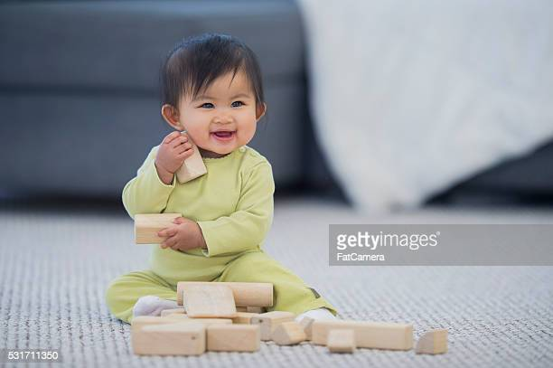 Happily Playing with Wood Blocks