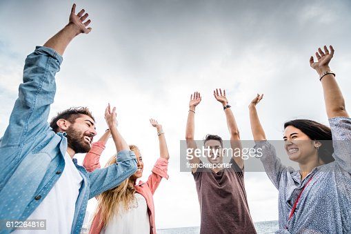 happiness all together with arm raised outdoors in barcelona : Stock Photo