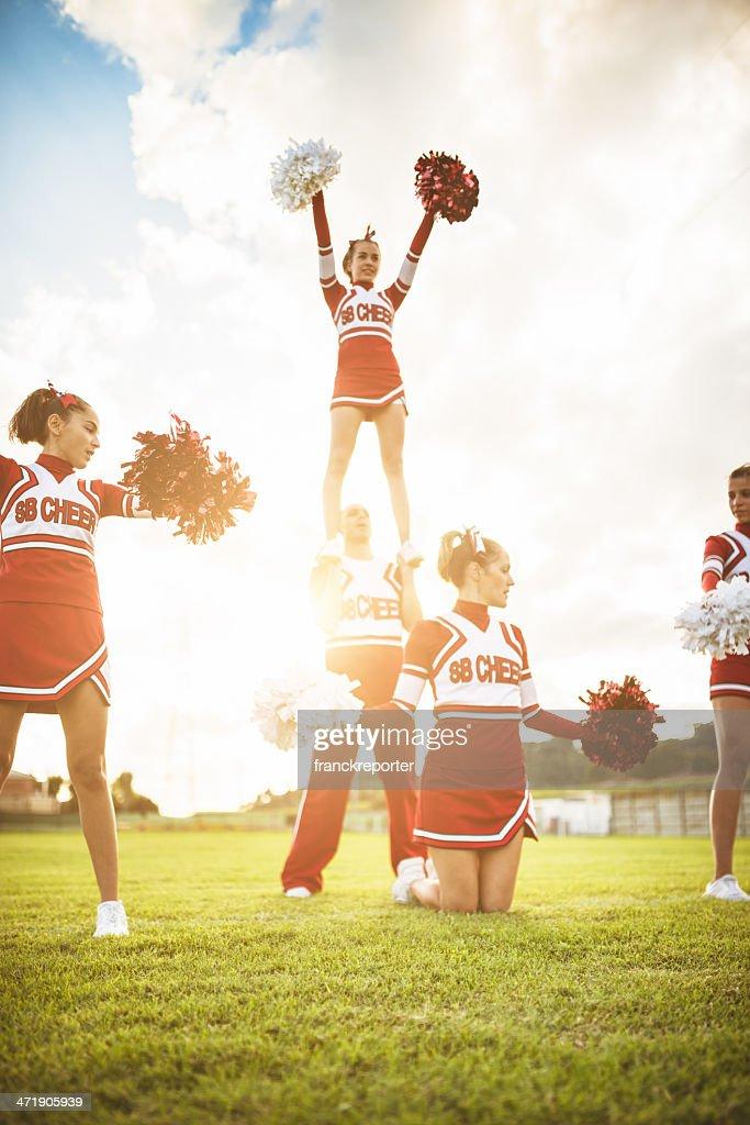 Happiness cheerleaders posing with pon-pon : Stock Photo