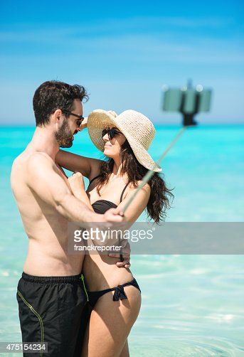 Happiness couple at the seaside take a selfie