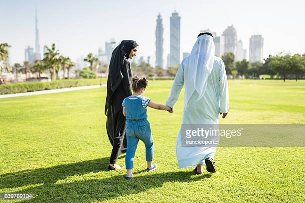 happiness family walking in the park in dubai