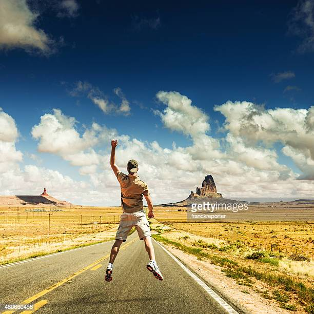 Happiness man jumping on the road
