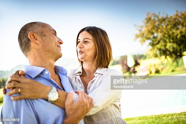 happiness mature couple embracing at the park