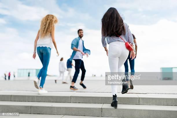 Happiness multiracial Friends walking in Barceloneta