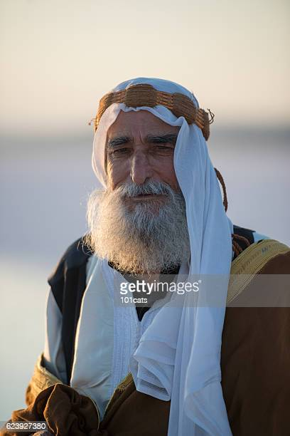 Happiness old Arabic man with traditional clothes