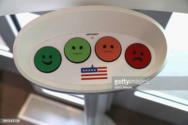 A happiness response monitor awaits immigrants departing the US Citizenship and Immigration Services Dallas Field Office on August 22 2016 in Irving...