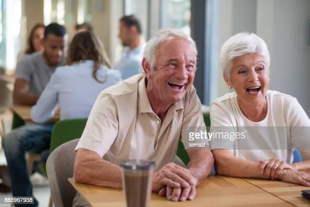 Happy active seniors in coffee shop