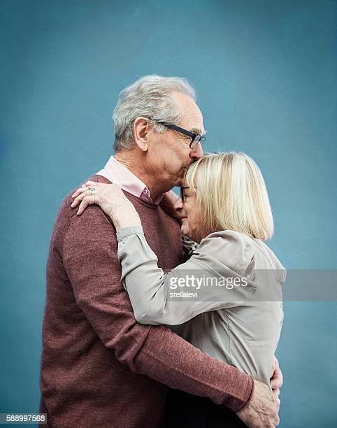 Happy affectionate Senior couple embracing