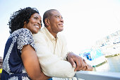 Happy African American couple looking out at the ocean