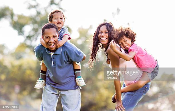 Happy african american family playing in nature