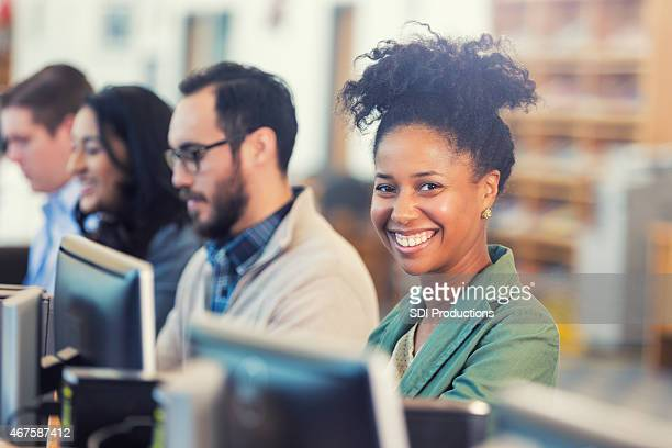 Happy African American woman continuing college education or job training