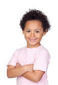 Happy african child with arms crossed isolated on white background