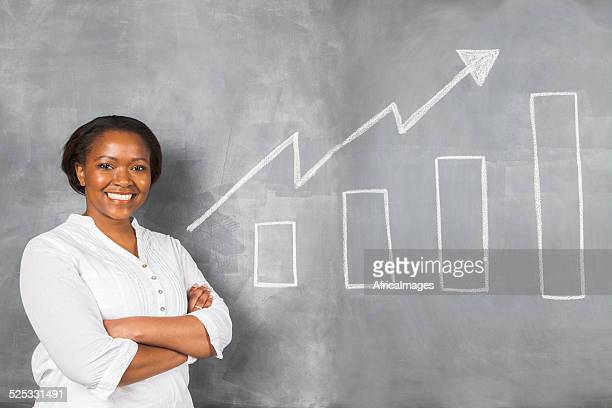Happy african woman proud of her savings growth.