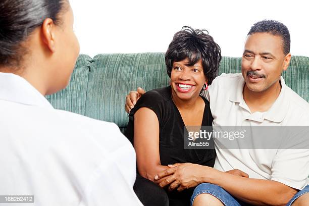 Happy african-american couple at the marriage counselor on white