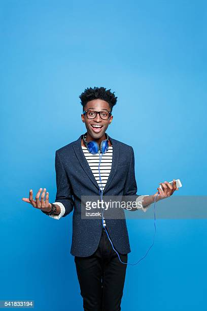 Happy afro american guy holding smart phone in hand