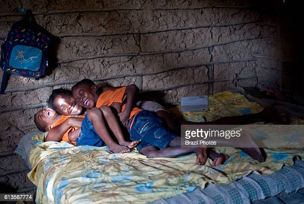 Happy AfroBrazilian family young mother and two boys at Sao Raimundo Quilombo in Alcantara Maranhao State Northeast Brazil a quilombo is a Brazilian...