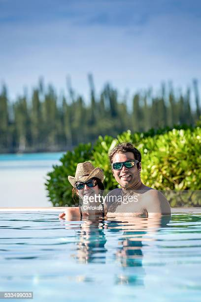 Happy and Loving Couple at Luxury Resort in Infinity Pool