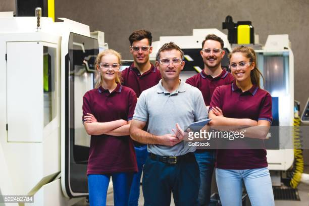 Happy Apprentices in Manufacturing