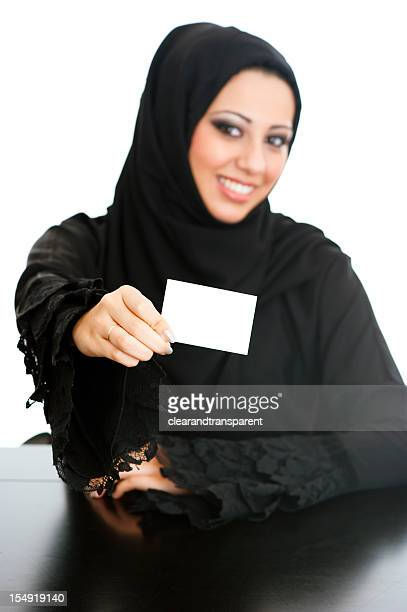 Happy Arabic girl holding card